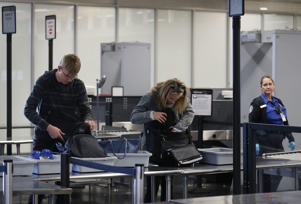 Travelers go through the TSA security checkpoint at the Fort Lauderdale-Hollywood International airport on March 14, 2017 in Fort Lauderdale, Florida.