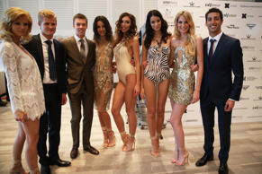 MONTE-CARLO, MONACO - MAY 23: (L-R) Marcus Ericsson of Sweden and Caterham, Daniil Kvyat of Russia and Scuderia Toro Rosso and Daniel Ricciardo of Australia and Infiniti Red Bull Racing pose with models prior to taking part in the Amber Lounge Fashion Show ahead of the Monaco Formula One Grand Prix at Circuit de Monaco on May 23, 2014 in Monte-Carlo, Monaco.