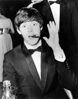 Paul McCartney, of the Merseyside, Liverpool beat group The Beatles, waves to th...