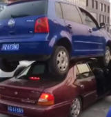 Car ends up on top of another car following accident