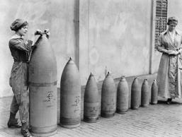 Women At Work During The First World War: Munitions Production, Chilwell, Nottinghamshire, England, UK, c. 1917, Two women munitions workers stand beside examples of the shells produced at National Shell Filling Factory No.6, Chillwell, Nottinghamshire d