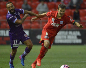 Diego Castro of Perth Glory and Isa'as Sanchez of United during the Round 25 A-League match between Adelaide United and Perth Glory.