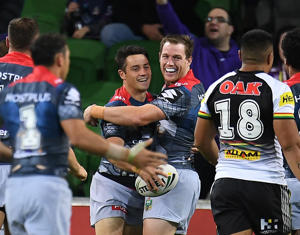 Storm players react after Cooper Cronk scored a try during the Round 5 NRL match.