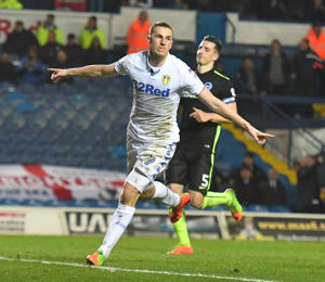 Chris Wood celebrates a goal for Leeds United.