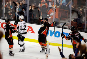 The Ducks' Nate Thompson (center) Brandon Montour (right) and Chris Wagner (left) celebrate a goal by Thompson as the Kings' Alec Martinez skates away during the third period on April 9 in Anaheim, Calif. The Ducks won 4-3 in overtime.