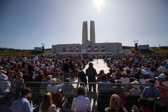 Slide 1 of 37: Thousands gather around the Canadian National Vimy Memorial during a Vimy centenary commemorative service on April 9, 2017 in Vimy, France.