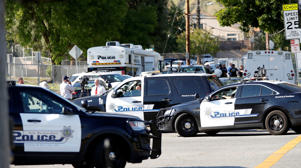 Police vehicles are pictured after a shooting at North Park Elementary School in San Bernardino, California, U.S., April 10, 2017.