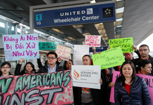 Community members protest the treatment of Dr. David Dao, who was forcibly removed from a United Airlines flight on Sunday by the Chicago Aviation Police, at O'Hare International Airport in Chicago, Illinois, U.S., April 11, 2017.