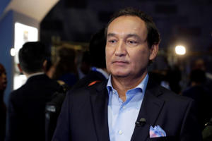 "In this Thursday, June 2, 2016, file photo, United Airlines CEO Oscar Munoz waits to be interviewed, in New York, during a presentation of the carrier's new Polaris service, a new business class product that will become available on trans-Atlantic flights. Munoz said in a note to employees Tuesday, April 11, 2017, that he continues to be disturbed by the incident Sunday night in Chicago, where a passenger was forcibly removed from a United Express flight. Munoz said he was committed to ""fix what's broken so this never happens again."""