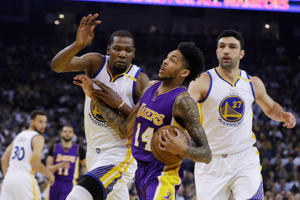 Los Angeles Lakers' Brandon Ingram (14) drives to the basket as Golden State Warriors' Kevin Durant, center left, and Zaza Pachulia (27) defend during the first half of an NBA basketball game Wednesday, April 12, in Oakland, Calif.