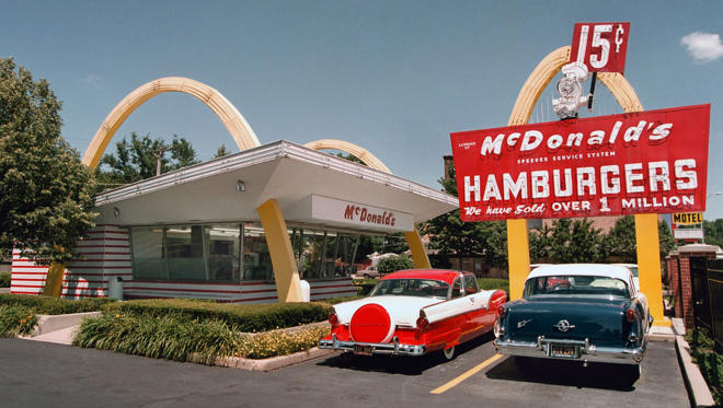 Slide 1 of 64: A 1955 Ford, left, and a 1955 Oldsmobile are parked in the lot of the McDonald's museum July 14, 2000 in Des Plaines, IL. On this site April 15, 1955 Ray Kroc, founder of the McDonald's franchise, opened his first restaurant.