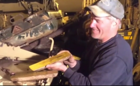 Military enthusiasts find gold bars worth £2m inside tank