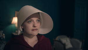"THE HANDMAID'S TALE -- ""Offred"" - Episode 101 - Offred, one the few fertile women known as Handmaids in the oppressive Republic of Gilead, struggles to survive as a reproductive surrogate for a powerful Commander and his resentful wife. Offred (Elisabeth Moss), shown."