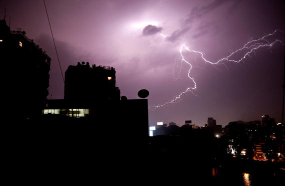 Slide 1 of 20: A thunder and lightning storm strikes Cairo, Egypt, Wednesday, April 12, 2017.  Torrential rain swamped the city, but no flooding was reported Wednesday.