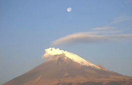 Timelapse shows moon over volcano