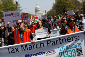 Tax Day demonstrators march away from the U.S. Capitol April 15, 2017 in Washington, DC. Activists gathered in cities nationwide to demand President Donald Trump release his tax returns.