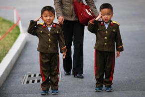 Boys wearing military uniforms salute as they are photographed in a zoo in Pyongyang, North Korea April 16, 2017. REUTERS/Damir