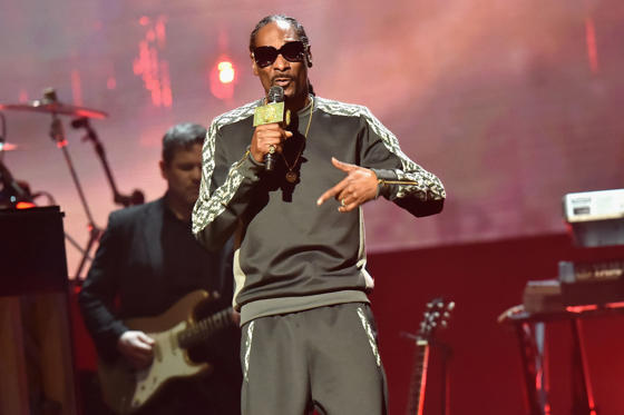Slide 1 of 101: NEW YORK, NY - APRIL 07: Snoop Dogg performs in honor of 2017 Inductee Tupac Shakur onstage at the 32nd Annual Rock & Roll Hall Of Fame Induction Ceremony at Barclays Center on April 7, 2017 in New York City. Debuting on HBO Saturday, April 29, 2017 at 8:00 pm ET/PT (Photo by Jeff Kravitz/FilmMagic)