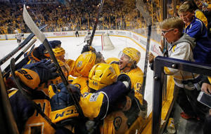 Kevin Fiala (56) of the Predators celebrates his game winning overtime goal with teammates against the Blackhawks on April 17 in Nashville, Tennessee. The Predators won 3-2.