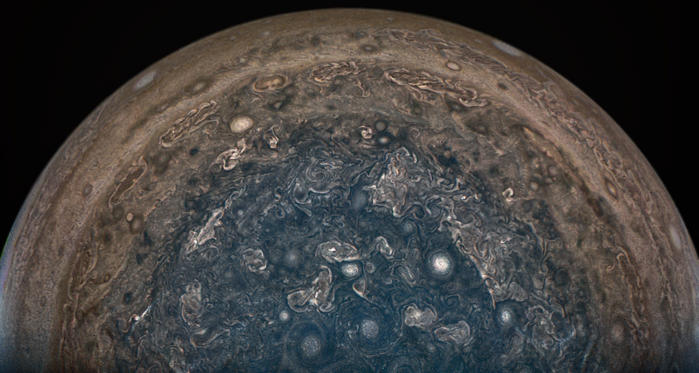 Slide 2 of 11: NASA's Juno spacecraft soared directly over Jupiter's south pole when JunoCam acquired this image.