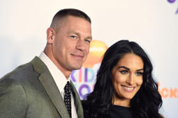 John Cena, left, and Nikki Bella arrive at the Kids' Choice Awards at the Galen Center on Saturday, March 11, 2017, in Los Angeles.