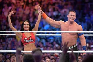 IMAGE DISTRIBUTED FOR WWE - WWE Superstars John Cena, right, and Nikki Bella show off the engagement ring after she accepted his marriage proposal during WrestleMania 33 on Sunday, April 2, 2017, in Orlando, Fla. (Phelan M. Ebenhack/AP Images for WWE)