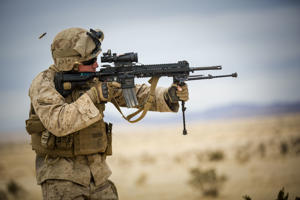 A U.S. Navy corpsman fires the M-27 rifle during live-fire training at Camp Wilson in Calif., on Jan. 20, 2015.