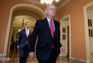 Senate Majority Leader Mitch McConnell of Ky. walks to his office on Capitol Hill in Washington on Thursday.