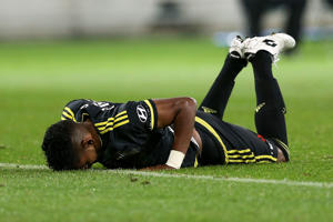 Roy Krishna of the Phoenix lies on the ground after being brought down in a tackle during the round 26 A-League match between the Wellington Phoenix and Sydney FC.