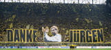 The team of Borussia Dortmund at the start of the match. The supporters thank coach Jurgen Klopp of Borussia Dortmund during the Bundesliga match between Borussia Dortmund and Werder Bremen on May 23, 2015 at the Signal Iduna Park in Dortmund, Germany.