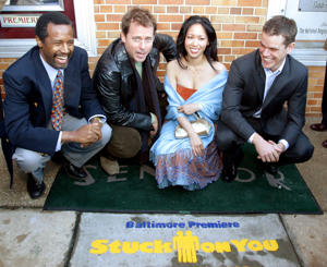 (From left) Dr. Ben Carson, Greg Kinnear, Wen Yann Shih and Matt Damon pose for a photo at the Baltimore premiere of the movie 'Stuck On You.'