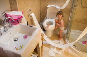Toddler making mess in bathroom