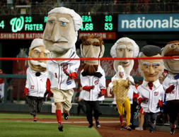 The Racing Presidents Washington Nationals mascots run during a baseball game against the San Diego Padres at Nationals Park, Wednesday, Aug. 26, 2015, in Washington.