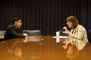 Student Hector Guevara is interviewed by Lucia Donat during work readiness training at the Los Angeles Area Chamber of Commerce.