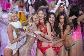 Models Martha Hunt (L-R), Candice Swanepoel, Behati Prinsloo, Lily Aldridge and Alessandra Ambrosio celebrate after presenting creations from the 2015 Victoria's Secret Fashion Show in New York, November 10, 2015.