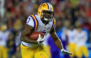 LSU Tigers running back Leonard Fournette (7) runs the ball during the fourth qu...