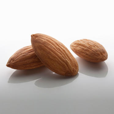 "Almonds are a great source of mono- and polyunsaturated fats, which can help lower your cholesterol and keep you slim. They also contain fewer calories than most other varieties of nuts (just 163 calories for 23), as well as plenty of fiber and vitamin E. According to a study in the International Journal of Obesity, people who added a daily serving of almonds to a low-calorie diet lost more weight than those who followed the same diet but ate a carb-heavy snack such as crackers instead. <br><br>To reap the benefits, Sass recommends using almonds to crust a lean protein such as salmon or sprinkling them onto salads and cooked veggies. ""You can also whip them into smoothies or use nut butter as the base for a savory sauce seasoned with garlic and ginger,"" she says.<br><br><b>RELATED: <a href=""http://www.health.com/health/gallery/0,,20676415,00.html"">The 20 Best Foods to Eat for Breakfast</a></b>"