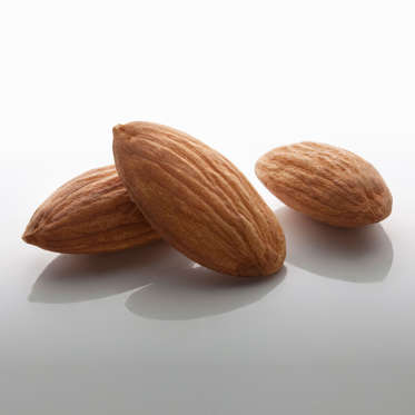"""Almonds are a great source of mono- and polyunsaturated fats, which can help lower your cholesterol and keep you slim. They also contain fewer calories than most other varieties of nuts (just 163 calories for 23), as well as plenty of fiber and vitamin E. According to a study in the International Journal of Obesity, people who added a daily serving of almonds to a low-calorie diet lost more weight than those who followed the same diet but ate a carb-heavy snack such as crackers instead. <br><br>To reap the benefits, Sass recommends using almonds to crust a lean protein such as salmon or sprinkling them onto salads and cooked veggies. """"You can also whip them into smoothies or use nut butter as the base for a savory sauce seasoned with garlic and ginger,"""" she says.<br><br><b>RELATED: <a href=""""http://www.health.com/health/gallery/0,,20676415,00.html"""">The 20 Best Foods to Eat for Breakfast</a></b>"""