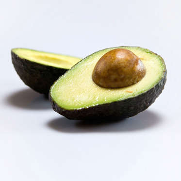 """Is there anything avocados can't do? This creamy superfood (loaded with monounsaturated fats, potassium, magnesium, folate, and vitamins C and E) has been linked to improved vision, good heart health, and a reduced risk of certain cancers. And avocados can also help whittle your middle: according to one study, people who regularly consume them weigh less and have smaller waists than those who do not. Another study found that women who eat half an avocado at lunchtime might experience reduced food cravings later in the day.<br><br>There are countless ways to enjoy the fruit (yes, technically it is one), but you can't beat the classic combination of whole-wheat toast with mashed avocado, lemon juice, and sunflower seeds. Sass also recommends whipping avocado into a smoothie, pureeing it with herbs and citrus juice to make a creamy salad dressing, or adding it to a veggie omelet.<br><br><b>RELATED: <a href=""""http://www.health.com/health/gallery/0,,20395687,00.html"""">8 Avocado Recipes (Besides Guacamole)</a></b>"""