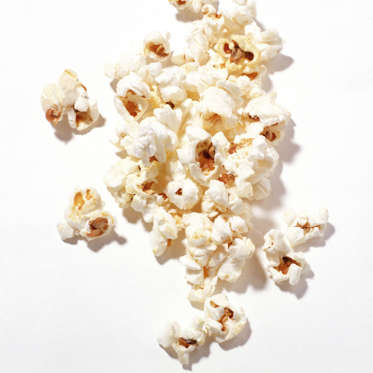 """With the notable exception of movie popcorn--which can contain upwards of 1,000 calories, thanks to all the butter drizzled on top--popcorn is a healthy, filling snack that's loaded with fiber and protein.<br><br>""""In addition to all of the benefits of being a member of the whole grain family, popcorn is light and airy, so you can eat a large portion,"""" says Sass. """"About three cups of popped popcorn--the size of three tennis balls--has the same amount of calories as one small handful of chips or crackers."""""""