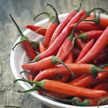 "The effect of chili peppers on your metabolism is real, says Sass. They contain a chemical compound called capsaicin that can increase your body's ability to burn fat (as much as 90 extra calories following a meal), and are also a good source of vitamin C.<br><br> ""You can add chili peppers to omelets or egg salad, sprinkle them into a stir-fry, or mix them into salad dressing, tahini, or guacamole,"" says Sass. ""You might even stir a little chili pepper into melted dark chocolate to drizzle over fruit."""