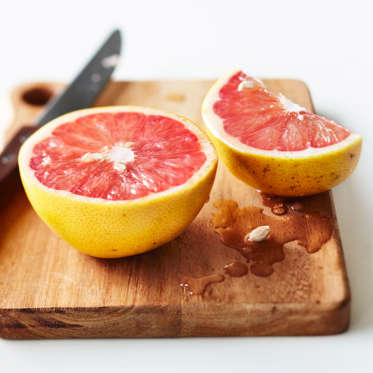 A fat-burning superfood, grapefruit contains a compound that can lower the fat-storage hormone insulin, which in turn can lead to weight loss. In fact, eating half a grapefruit before each meal could help you lose up to a pound a week--even if you don't change anything else about your diet. Because grapefruits are 90% water, which fills you up, they also act as a natural appetite suppressant.<br><br>Bonus: Research suggests that this superfruit can also help protect your heart and maintain firm, healthy skin.
