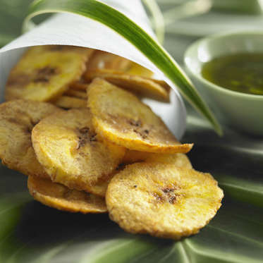 Plantains are a slightly bigger, starchier, and less sweet member of the banana family. Like their cousin, plantains are a great source of resistant starch, containing nearly 3 grams in a half-cup when cooked.<br><br>Haven't prepared plantains before? It couldn't be easier: Sauté them in olive oil until they're slightly crispy to make plantain 'chips' or bake with seasonings like lime juice and honey.