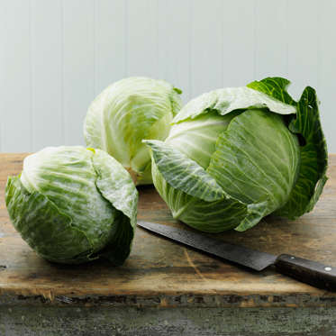 """Cabbage is rich in antioxidants and vitamin C but extremely low in calories (just 22 per cup), so you can fill your plate with the leafy green guilt-free. And while you're probably familiar with the infamous <a href=""""http://www.health.com/health/article/0,,20410207,00.html"""">Cabbage Soup Diet</a>, there are plenty of alternate ways to eat this veggie that won't leave you feeling hungry. It's delicious in a variety of slaws or salads, and makes a crunchy garnish atop tacos or burgers.<br><br><b>RELATED: <a href=""""http://www.health.com/health/gallery/0,,20684235,00.html"""">23 Easy Cabbage Recipes</a></b>"""