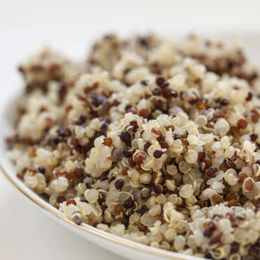 """Quinoa contains a hearty dose of the minerals iron and magnesium, which help give your body energy. And a one-cup serving of the grain boasts 8 grams of protein and 5 grams of fiber, increasing feelings of fullness. It's also gluten-free, making it a safe choice for people with celiac disease.<br><br>Confused at how to actually cook quinoa? The pseudograin (it's technically a seed!) is easy to prepare and extremely versatile--it's delicious on its own or in a salad, can be used to make burger patties or pancakes, or could even be baked into cookies and muffins.<br><br><b>RELATED: <a href=""""http://www.health.com/health/gallery/0,,20842245,00.html"""">15 Creative Quinoa Recipes</a></b>"""