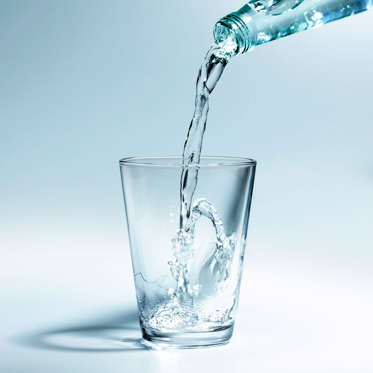 """Add this to your list of reasons to drink plenty of H2O: Because the symptoms of hunger are similar to those of dehydration, it's possible for your body to mistake thirst for hunger, tricking you into eating more than you need to.<br><br>Drinking enough water can help you stay slim, too. Research from the American Chemical Society in Boston found that having two 8-ounce glasses of water before a meal while also reducing portion sizes could help you lose weight and keep it off. Not to mention, water fills you up, curbing your appetite: """"In addition to slightly boosting your metabolism, drinking water before meals has been shown to help you eat less without trying,"""" says Sass.<br><br><b>RELATED: <a href=""""http://www.health.com/health/gallery/0,,20396298,00.html"""">15 Big Beauty Benefits of Water</a></b>"""