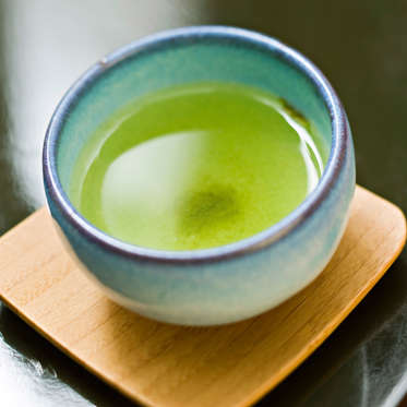 If you want to sip your way to a faster metabolism, pour yourself a cup of green tea. The beverage is filled with powerful antioxidants that can help fight inflammation, burn fat, and increase energy. According to one study, drinking five cups a day could help you lose twice as much weight, mainly in your midsection. And drinking green tea could also reduce risk of Parkinson's disease, as well as ovarian, colorectal, skin, and prostate cancers.<br><br>For an extra boost, squeeze a slice of lemon or orange into your tea before drinking it: research from Purdue University found that citrus juice gives green tea's antioxidants staying power, so they're digested slowly and benefit your body for longer.