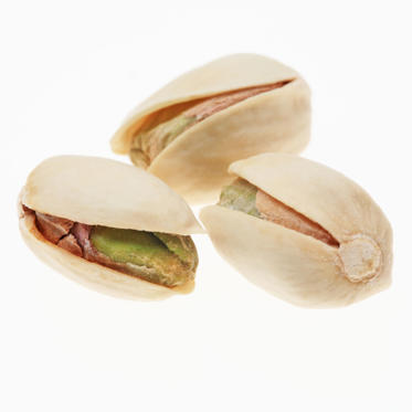 "Pistachios may be small, but these green-hued nuts contain as much potassium as a banana and are packed with lutein, an antioxidant that benefits your eyes and skin. They also have fewer calories than any other nut variety.<br><br>For greater slimming potential, purchase them unshelled: the process of removing the shells will force you to eat more slowly, giving your brain additional time to determine whether or not you're still hungry.<br><br><b>RELATED: <a href=""http://www.health.com/health/gallery/0,,20409600,00.html"">The Best Healthy Nuts</a></b>"