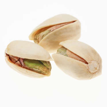 """Pistachios may be small, but these green-hued nuts contain as much potassium as a banana and are packed with lutein, an antioxidant that benefits your eyes and skin. They also have fewer calories than any other nut variety.<br><br>For greater slimming potential, purchase them unshelled: the process of removing the shells will force you to eat more slowly, giving your brain additional time to determine whether or not you're still hungry.<br><br><b>RELATED: <a href=""""http://www.health.com/health/gallery/0,,20409600,00.html"""">The Best Healthy Nuts</a></b>"""