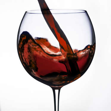 """Good news, wine drinkers. Thanks to <a href=""""http://www.health.com/health/article/0,,20428689,00.html"""">resveratrol</a>, an antioxidant found in grape skin, drinking red wine in moderation can be part of a healthy diet. Some studies suggest that people who drink wine have smaller waists and less abdominal fat than those who drink mainly liquor. And having one glass of red wine can increase your body's calorie burn for up to 90 minutes afterwards. The antioxidants in wine might even help your body prevent cancer and improve heart health. Just be sure to stick to no more than a glass a day--the calories can add up fast.<br><br><b>RELATED: <a href=""""http://www.health.com/health/gallery/0,,20500694,00.html"""">How Alcohol Affects Your Body</a></b>"""